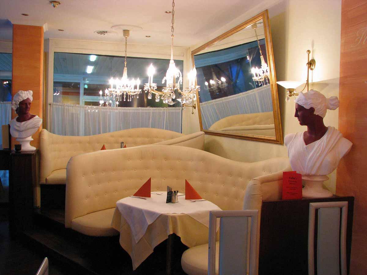 Pizzerie Restaurant Planung - Fabios - ein gemütlicher Sitzbereich im mediterranem Stil von Milo